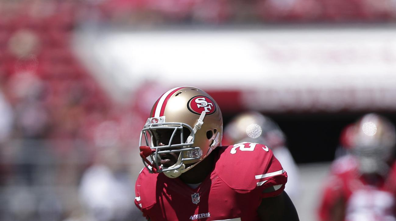 FILE - In this Aug. 24, 2014, file photo, San Francisco 49ers strong safety Jimmie Ward (25) warms up before an NFL preseason football game against the San Diego Chargers in Santa Clara, Calif. Ward is wearing a snazzy new shoe these days. Just one. The 4