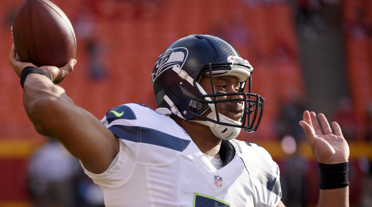 Seattle Seahawks quarterback Russell Wilson (3) warms up before an NFL football game against the Kansas City Chiefs at Arrowhead Stadium in Kansas City, Mo., Friday, Aug. 21, 2015. (AP Photo/Ed Zurga)