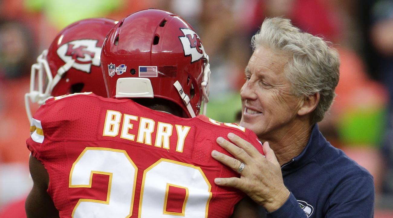 Seattle Seahawks head coach Pete Carroll greets Kansas City Chiefs strong safety Eric Berry (29) before an NFL football game at Arrowhead Stadium in Kansas City, Mo., Friday, Aug. 21, 2015. (AP Photo/Charlie Riedel)