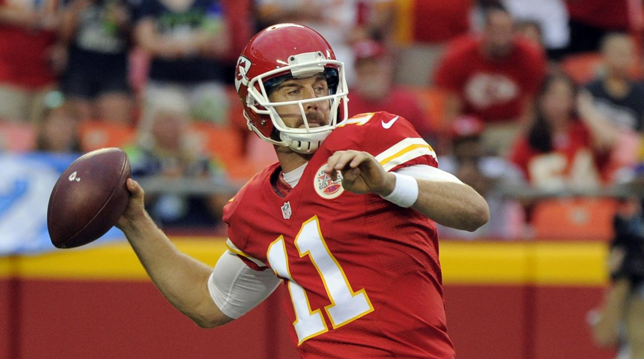 Kansas City Chiefs quarterback Alex Smith (11) passes to a teammate during the first half of an NFL football game against the Seattle Seahawks at Arrowhead Stadium in Kansas City, Mo., Friday, Aug. 21, 2015. (AP Photo/Ed Zurga)