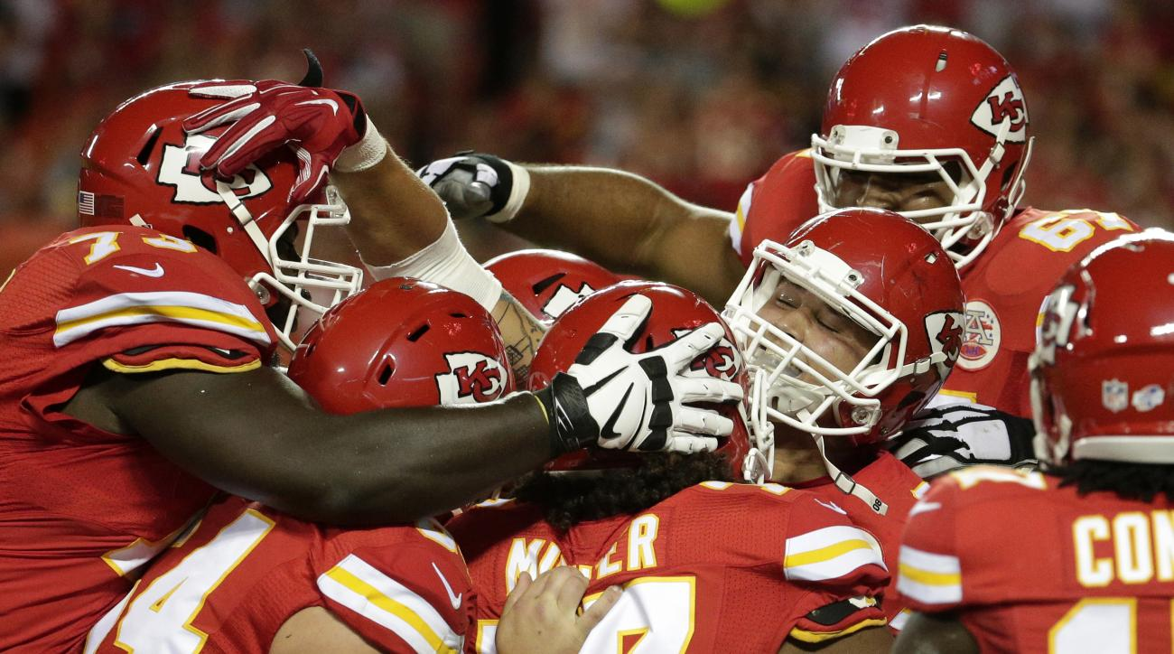 Kansas City Chiefs tight end James O'Shaughnessy, middle, celebrates his touchdown with teammate during the second half of a NFL preseason football game against the Seattle Seahawks at Arrowhead Stadium in Kansas City, Mo., Friday, Aug. 21, 2015. (AP Phot