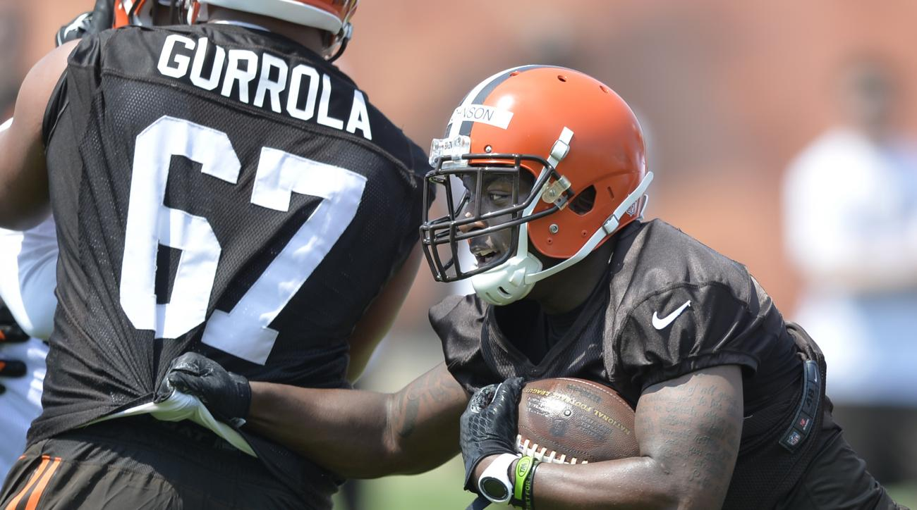 FILE- In this May 8, 2015, file photo, Cleveland Browns running back Duke Johnson, right, runs with the ball during NFL football practice in Berea, Ohio. Wide receiver Dwayne Bowe and Johnson have both missed Cleveland's first two exhibition games and are