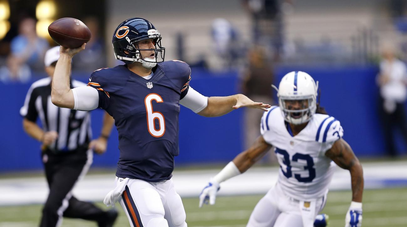 Indianapolis Colts defensive back Dwight Lowery (33) chases Chicago Bears quarterback Jay Cutler (6) during the first half of an NFL preseason football game in Indianapolis, Saturday, Aug. 22, 2015. (AP Photo/Sam Riche)
