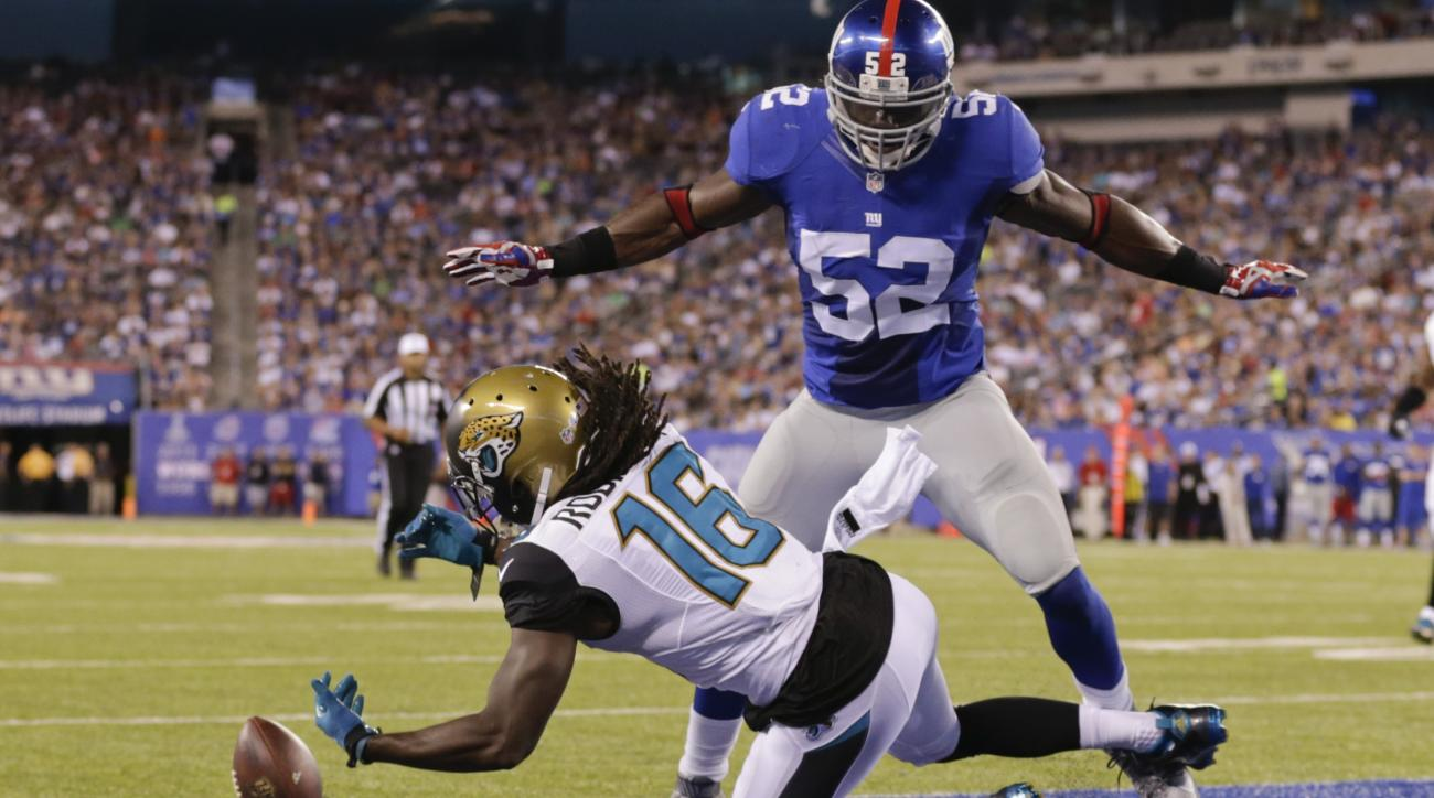 New York Giants middle linebacker Jon Beason (52) breaks up a pass to Jacksonville Jaguars' Denard Robinson (16) in the end zone during the first half of a preseason NFL football game Saturday, Aug. 22, 2015, in East Rutherford, N.J. (AP Photo/Adam Hunger