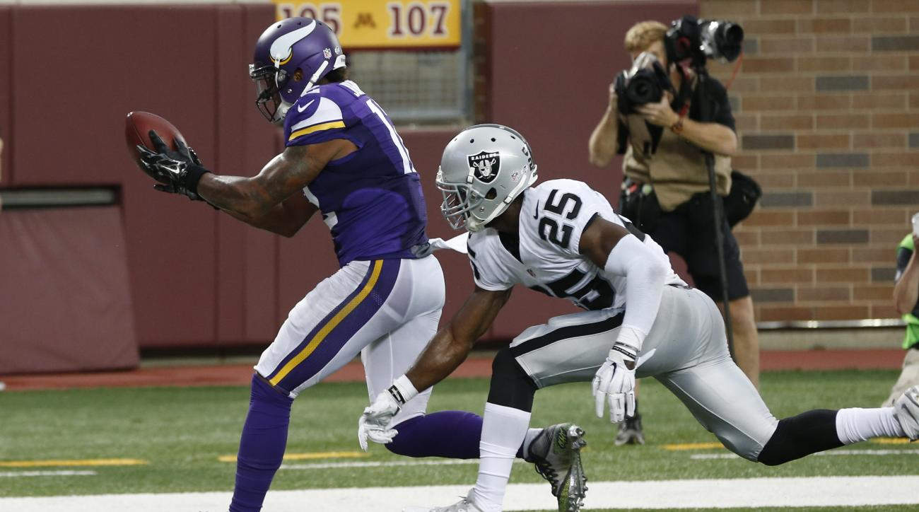 Minnesota Vikings wide receiver Charles Johnson catches a 10-yard pass for a touchdown defended by Oakland Raiders cornerback D.J. Hayden during the first half of a preseason NFL football game, Saturday, Aug. 22, 2015, in Minneapolis. (AP Photo/Jim Mone)