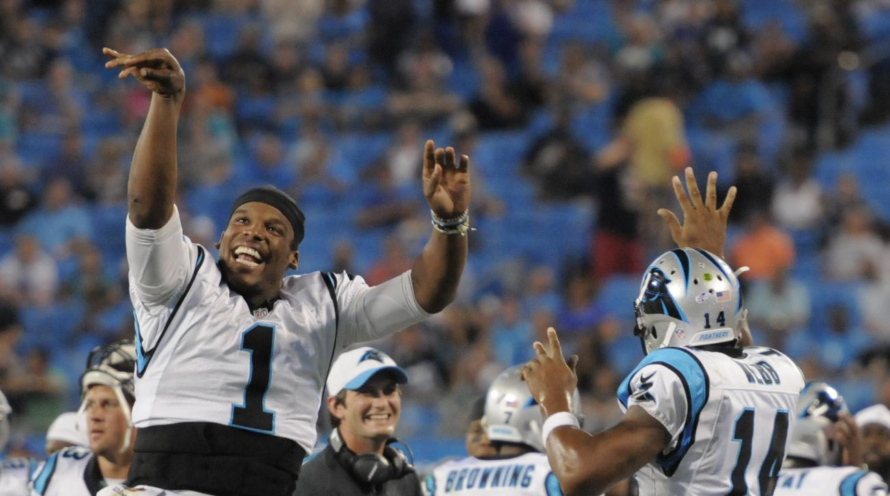 Carolina Panthers' Cam Newton (1) and Joe Webb (14) celebrate a touchdown against the Miami Dolphins during the second half of an NFL preseason football game in Charlotte, N.C., Saturday, Aug. 22, 2015. (AP Photo/Mike McCarn)