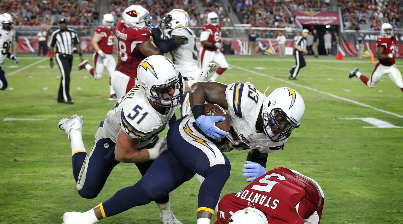 San Diego Chargers inside linebacker Kavell Conner (53) is tackled by Arizona Cardinals quarterback Drew Stanton (5) after an interception during the first half of an NFL preseason football game, Saturday, Aug. 22, 2015, in Glendale, Ariz. (AP Photo/Ross