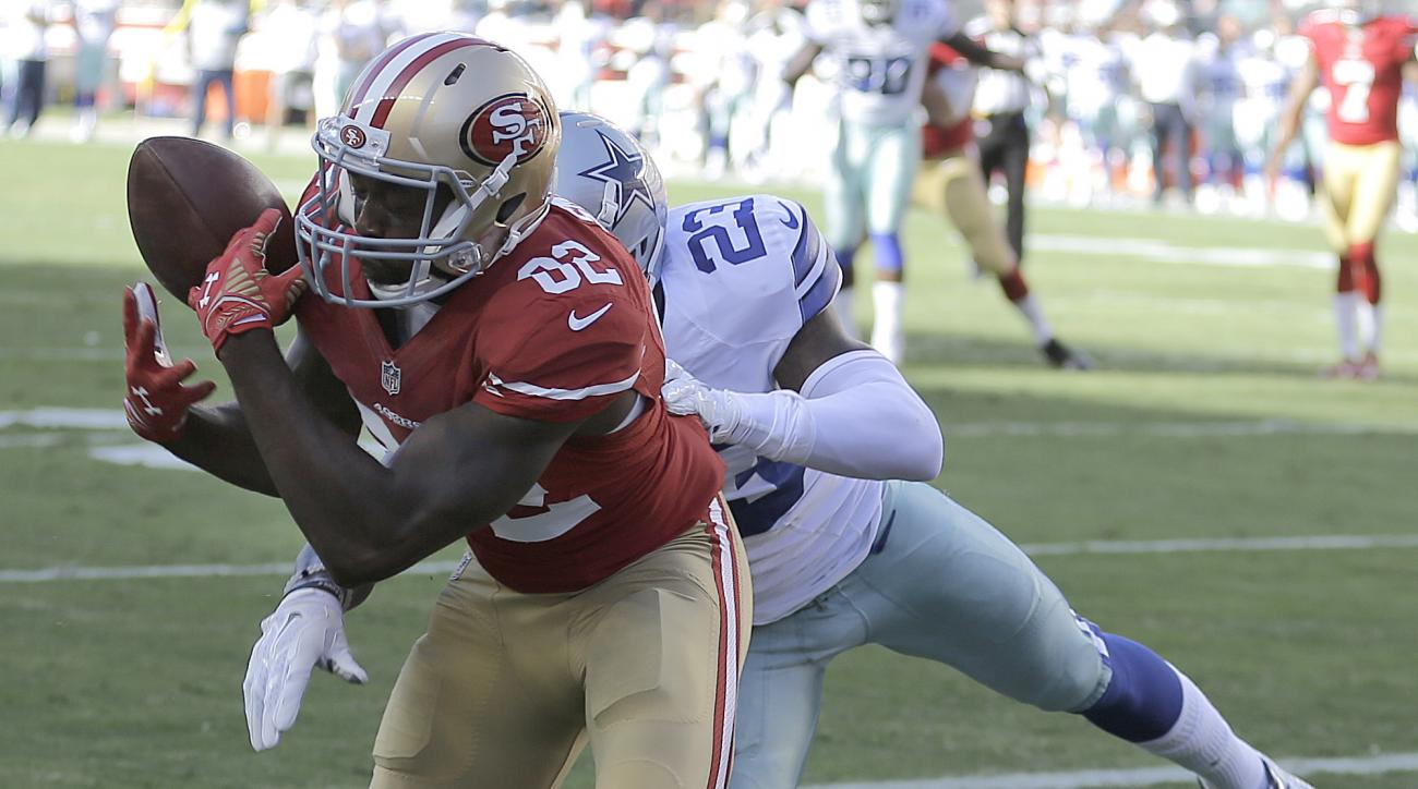 San Francisco 49ers wide receiver Torrey Smith (82) can't catch a pass in the end zone in front of Dallas Cowboys defensive back Corey White (23) during the first half of an NFL preseason football game in Santa Clara, Calif., Sunday, Aug. 23, 2015. (AP Ph