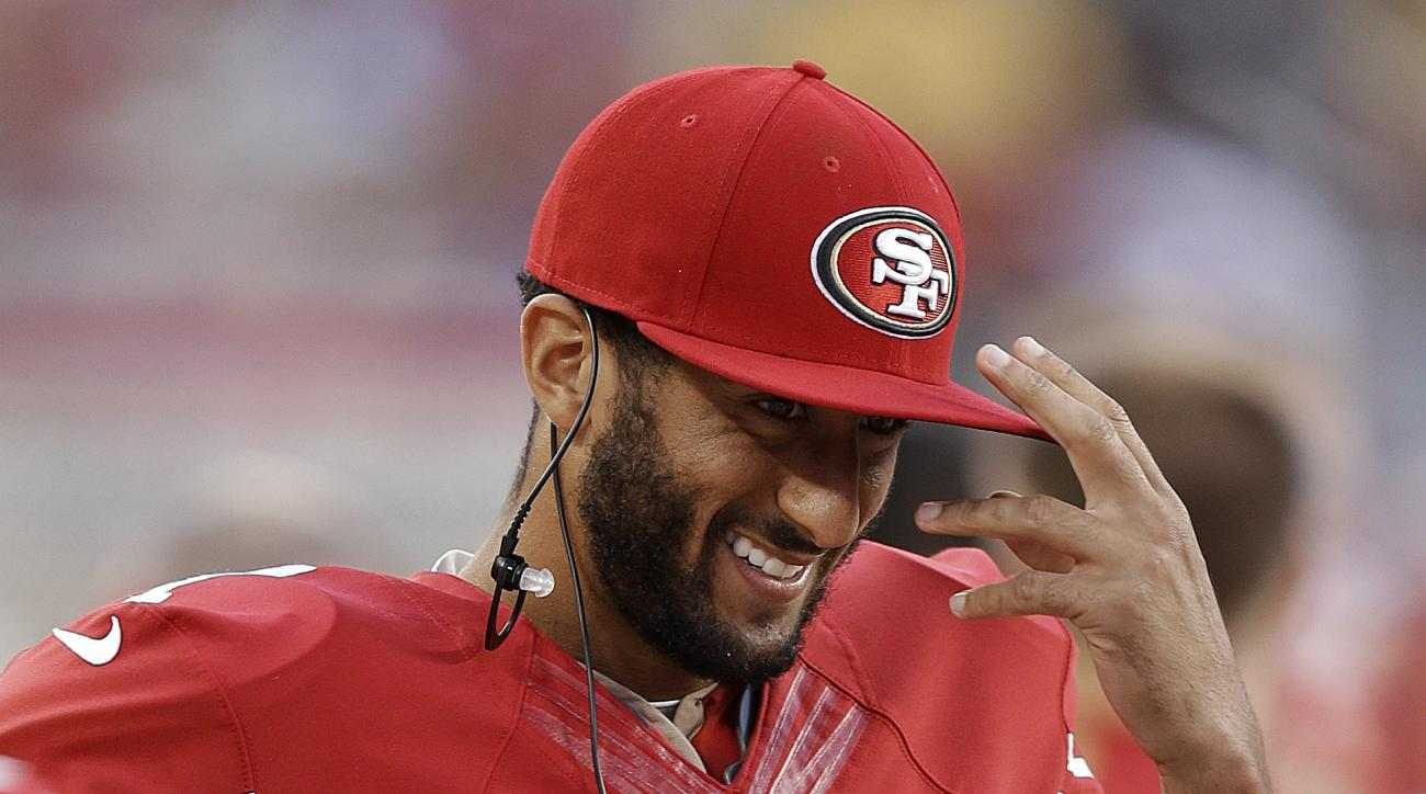 San Francisco 49ers quarterback Colin Kaepernick smiles while standing on the sideline during the second half of an NFL preseason football game against the Dallas Cowboys in Santa Clara, Calif., Sunday, Aug. 23, 2015. (AP Photo/Ben Margot)