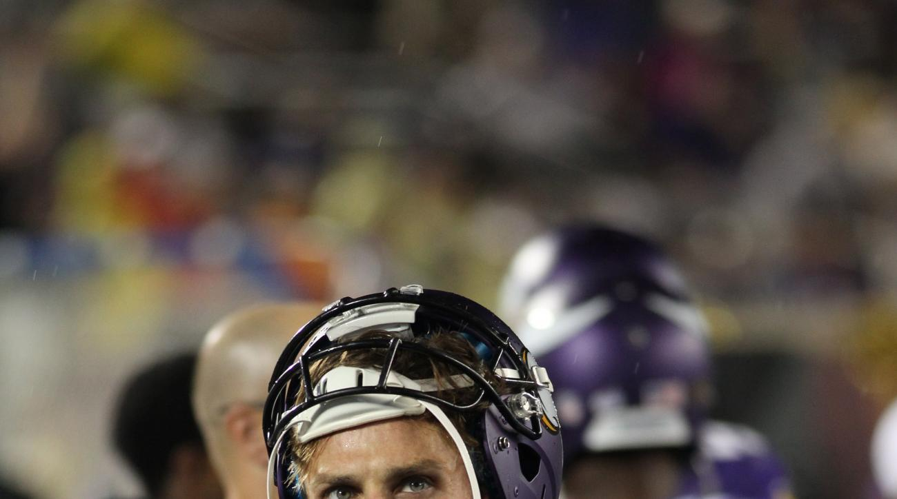 FILE - In this Aug. 22, 2015, file photo, Minnesota Vikings kicker Blair Walsh stands in the bench area during the second half of a preseason NFL football game against the Oakland Raiders in Minneapolis. The Vikings gave Blair Walsh a contract extension i