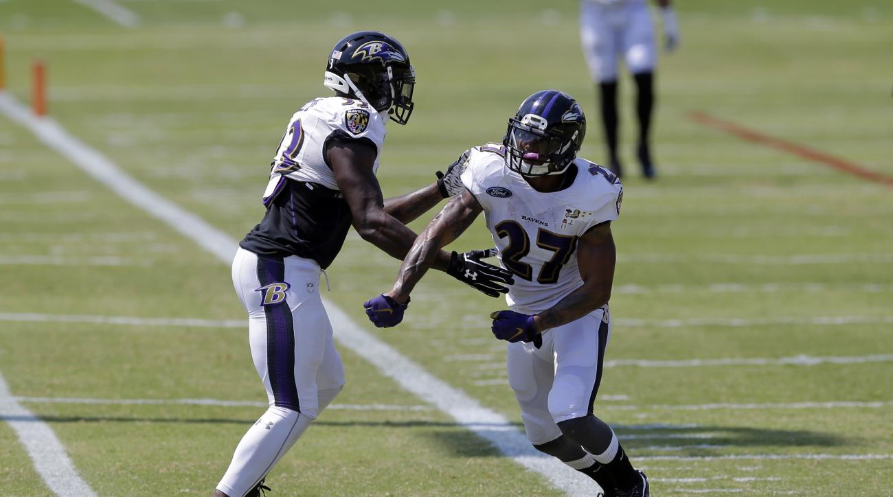 Baltimore Ravens strong safety Will Hill, left, and cornerback Asa Jackson run a drill during NFL football training camp, Monday, Aug. 24, 2015, in Owings Mills, Md. (AP Photo/Patrick Semansky)