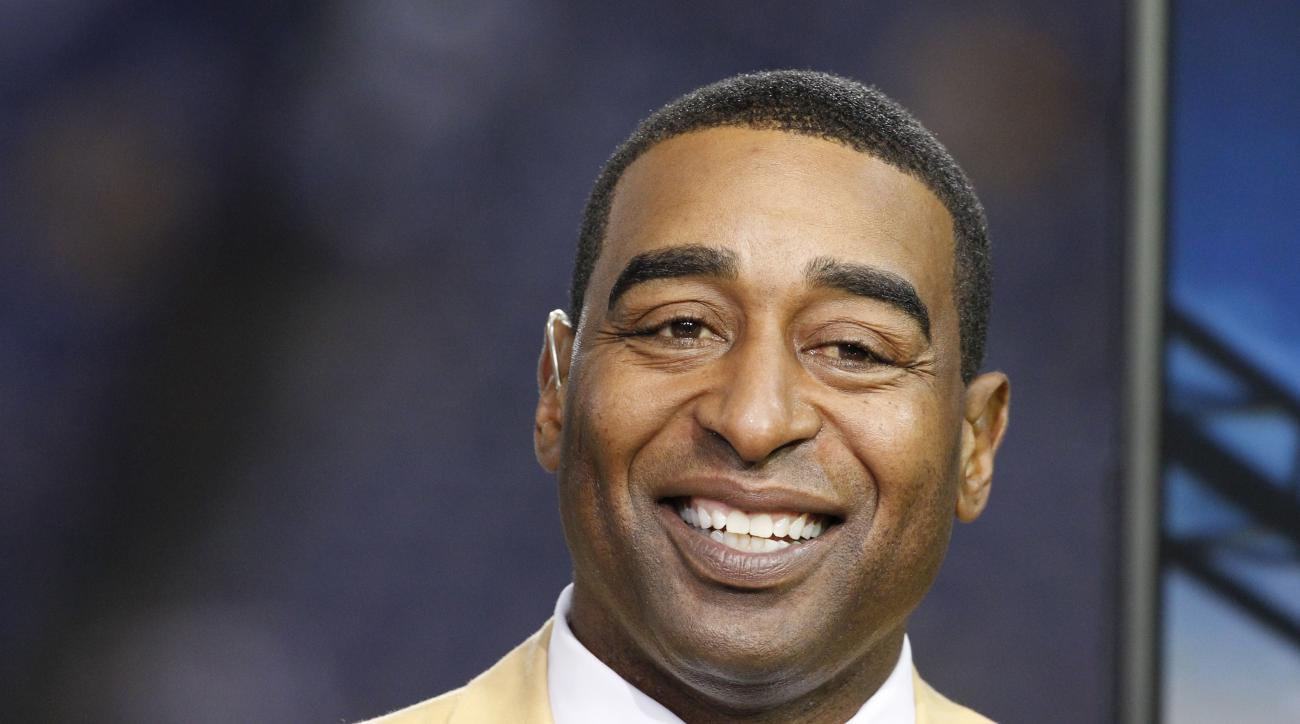 FILE - This is a Nov. 7, 2013, file photo showing Cris Carter smiling in the NFL booth during the first half of an NFL football game between the Minnesota Vikings and Washington Redskins in Minneapolis. Hall of Fame receiver Cris Carter has issued an apol