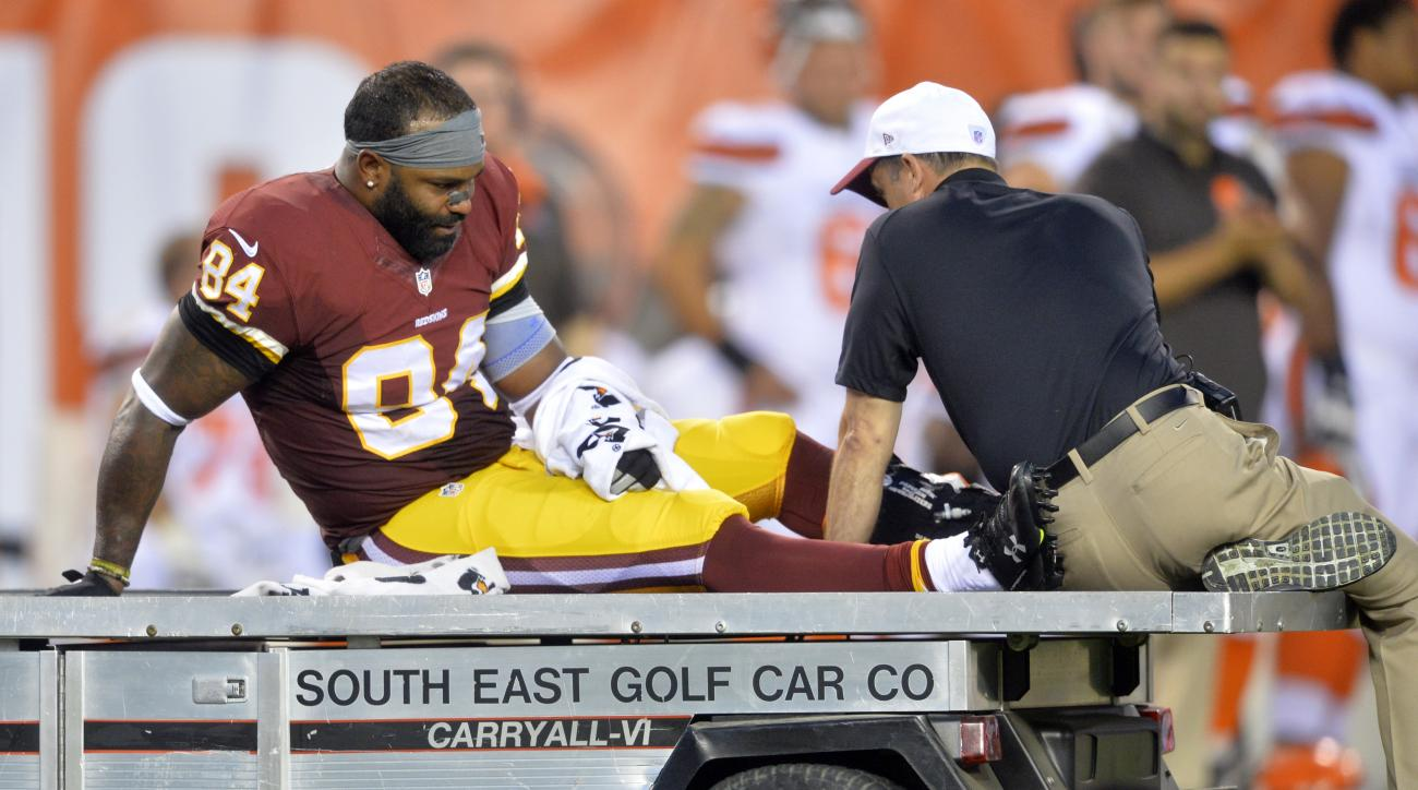 FILE - In this Aug. 13, 2015, file photo, Washington Redskins tight end Niles Paul (84) leaves the game in the first quarter after an injury during an NFL preseason football game against the Cleveland Browns in Cleveland. The games don't count. That makes