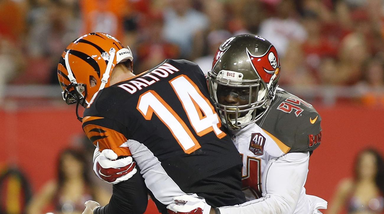 Tampa Bay Buccaneers defensive end George Johnson, right, sacks Cincinnati Bengals quarterback Andy Dalton, left, during the first quarter of an NFL preseason football game Monday, Aug. 24, 2015, in Tampa, Fla. (AP Photo/Brian Blanco)