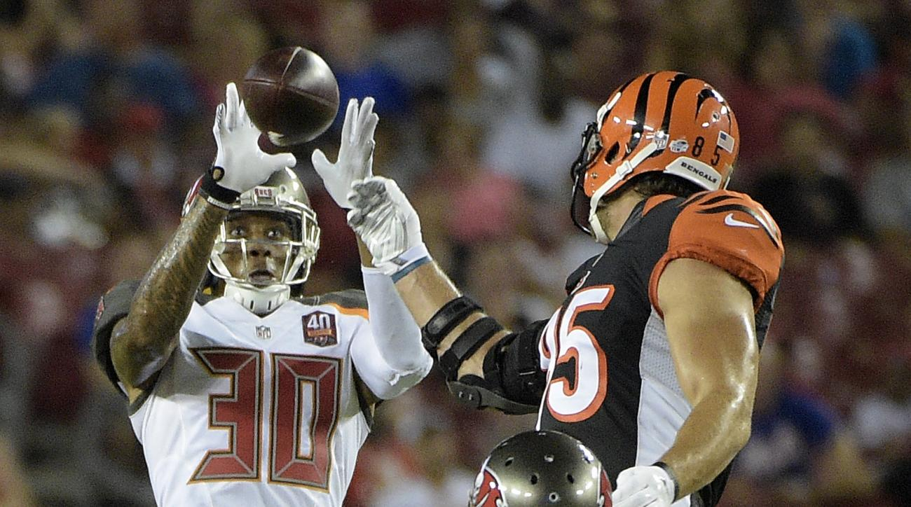 Tampa Bay Buccaneers strong safety Bradley McDougald (30) intercepts a pass intended for Cincinnati Bengals tight end Tyler Eifert (85) during the second quarter of an NFL preseason football game Monday, Aug. 24, 2015, in Tampa, Fla. Looking on is Buccane