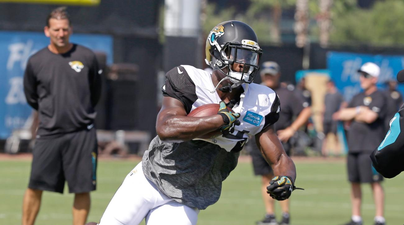 FILE - In this Aug. 6, 2015, file photo, Jacksonville Jaguars running back T.J. Yeldon runs the ball during practice at NFL football training camp in Jacksonville, Fla. Yeldon eagerly awaits his NFL debut against the Detroit Lions on Friday night, Aug. 28