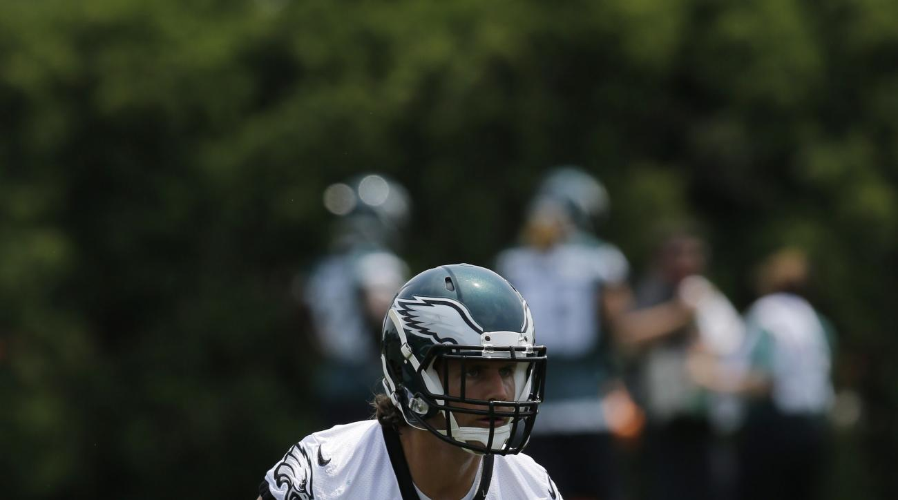 FILE - In this June 8, 2015, file photo, Philadelphia Eagles' Kiko Alonso watches a drill during organized team activities at the NFL football team's practice facility in Philadelphia. Alonso, Mychal Kendricks and DeMeco Ryans give the Eagles a formidable