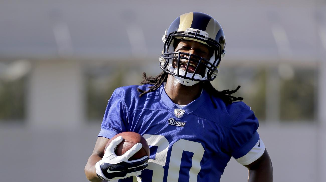 St. Louis Rams running back Todd Gurley runs with the ball during training camp at the NFL football team's practice facility Tuesday, Aug. 25, 2015, in St. Louis. Gurley has been cleared to practice with the St. Louis Rams, but the 10th overall pick in th