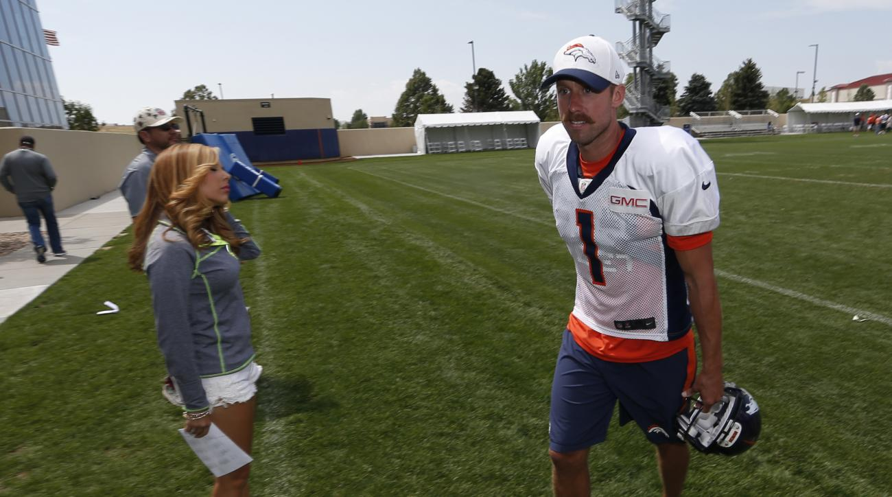 FILE - In this Aug. 18, 2015, file photo, Denver Broncos kicker Connor Barth heads off the field after the morning session at the team's NFL football training camp in Englewood, Colo. The Broncos have released kicker Connor Barth to make room for Pro Bowl