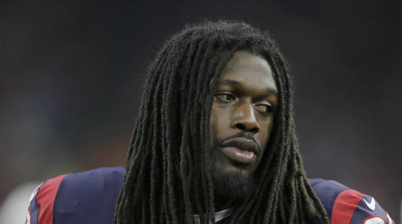Houston Texans' Jadeveon Clowney on the sideline during the first half of an NFL preseason football game against the Denver Broncos, Saturday, Aug. 22, 2015, in Houston. (AP Photo/Patric Schneider)