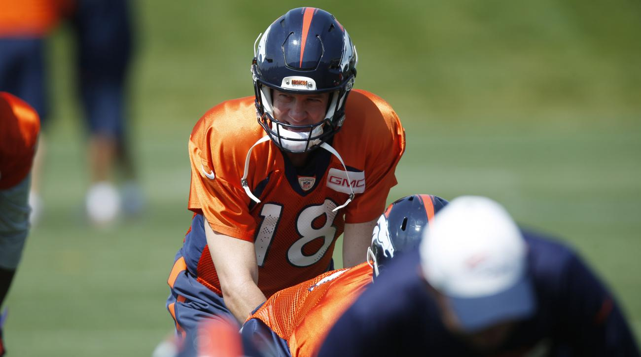Denver Broncos quarterback Peyton Manning takes a snap during an NFL football scrimmage against the San Francisco 49ers at the Broncos' headquarters Wednesday, Aug. 26, 2015, in Englewood, Colo. (AP Photo/David Zalubowski)