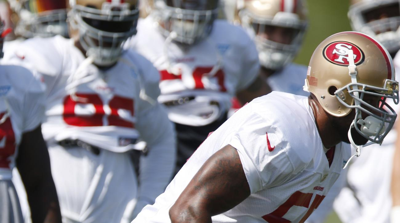 In this Wednesday, Aug. 26, 2015, photograph, San Francisco 49ers linebacker Ahmad Brooks takes part in drills before an NFL football scrimmage at the Denver Broncos' headquarters Wednesday, Aug. 26, 2015, in Englewood, Colo. (AP Photo/David Zalubowski)