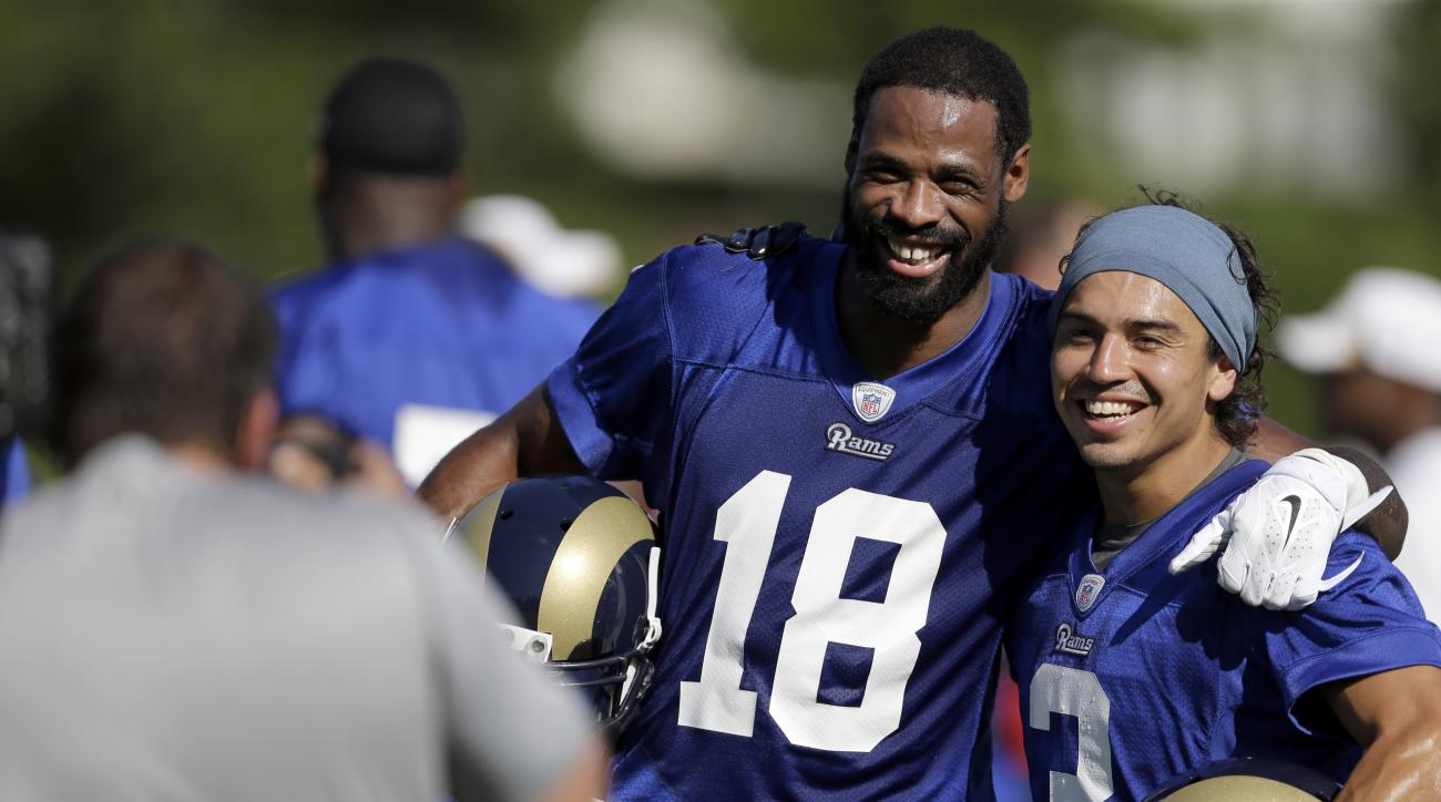 FILE- In this July 31, 2015, file photo, St Louis Rams wide receiver Kenny Britt (18) and wide receiver Daniel Rodriguez have their picture taken during training camp at the NFL football team's practice facility  in St. Louis. Long after the rest of the S