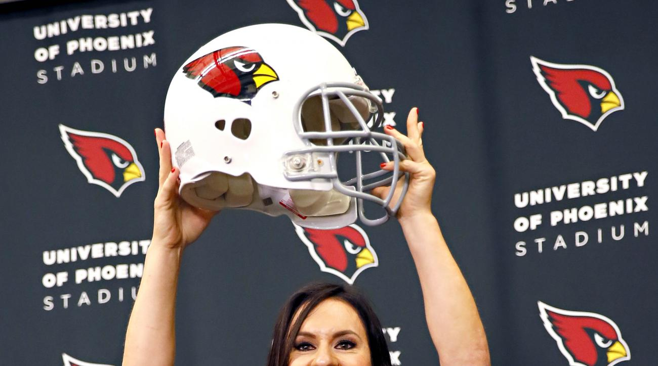 FILE - In this July 28, 2015, file photo, Arizona Cardinals training camp coach Jen Welter poses for photographers after being introduced at the teams' training facility in Tempe, Ariz. Her groundbreaking stint as coaching intern with the Arizona Cardinal