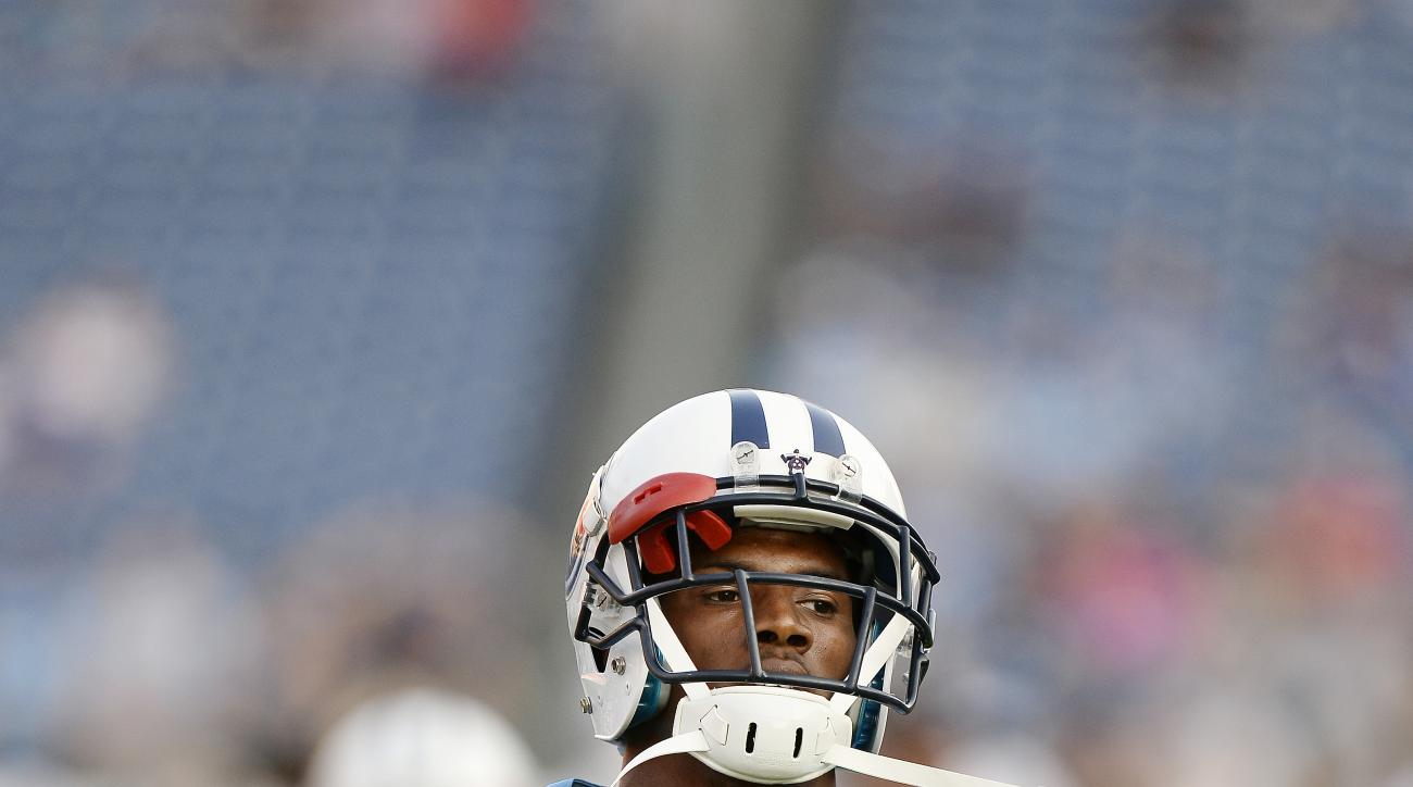 Tennessee Titans wide receiver Justin Hunter warms up before a preseason NFL football game against the St. Louis Rams Sunday, Aug. 23, 2015, in Nashville, Tenn. (AP Photo/Mark Zaleski)