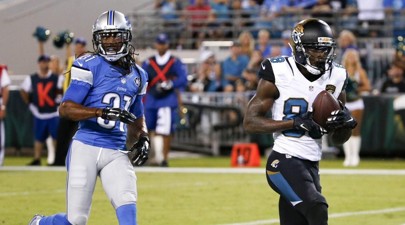 Jacksonville Jaguars wide receiver Allen Hurns, right, catches a pass for a 13-yard touchdown in front of Detroit Lions cornerback Rashean Mathis during the first half of an NFL preseason football game in Jacksonville, Fla., Friday, Aug. 28, 2015. (AP Pho