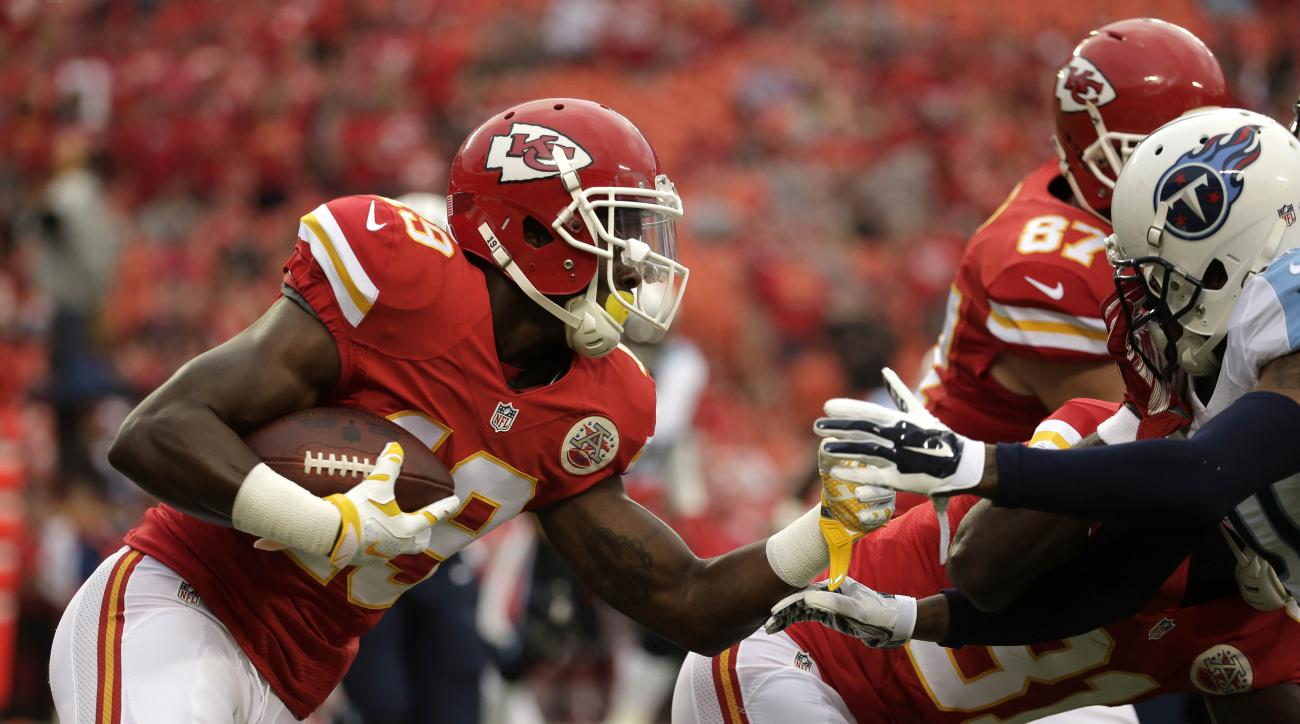 Kansas City Chiefs wide receiver Jeremy Maclin, left, tries to run past Tennessee Titans safety Da'Norris Searcy, right, during the first half of a preseason NFL football game at Arrowhead Stadium in Kansas City, Mo., Friday, Aug. 28, 2015. (AP Photo/Char