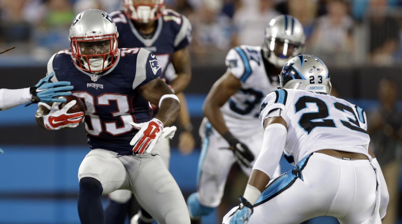 New England Patriots' Dion Lewis (33) carries as Carolina Panthers' Melvin White (23) defends during the second half of a preseason NFL football game in Charlotte, N.C., Friday, Aug. 28, 2015. (AP Photo/Bob Leverone)