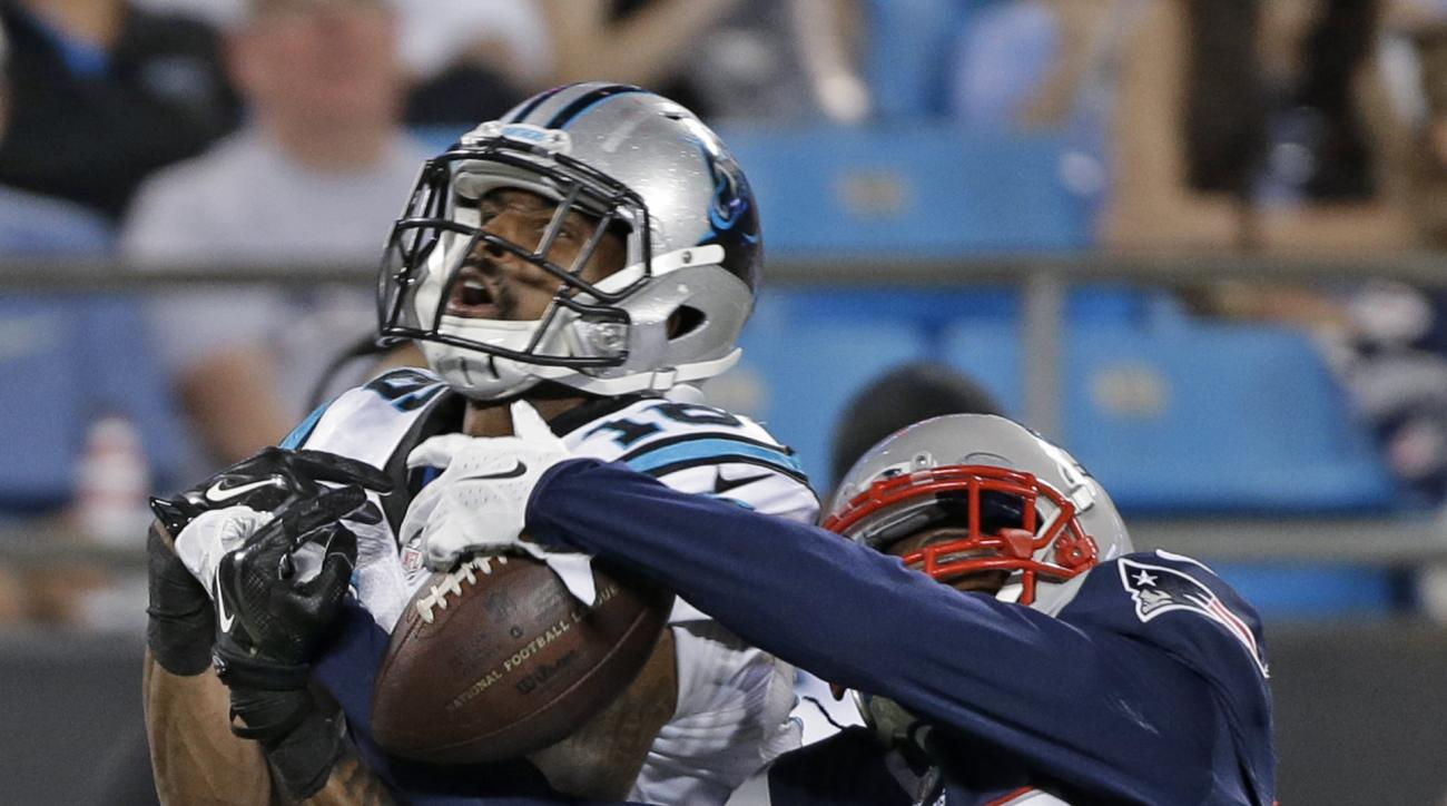 New England Patriots' Daxton Swanson, front, defends a pass to Carolina Panthers' Corey Brown during the second half of a preseason NFL football game in Charlotte, N.C., Friday, Aug. 28, 2015. The pass was incomplete. (AP Photo/Bob Leverone)