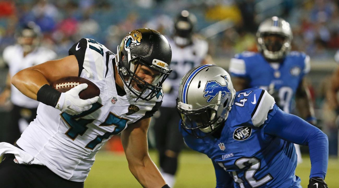 Jacksonville Jaguars tight end Connor Hamlett (47) runs against Detroit Lions strong safety Isa Abdul-Quddus (42) during the second half of an NFL preseason football game in Jacksonville, Fla., Friday, Aug. 28, 2015. (AP Photo/Stephen B. Morton)