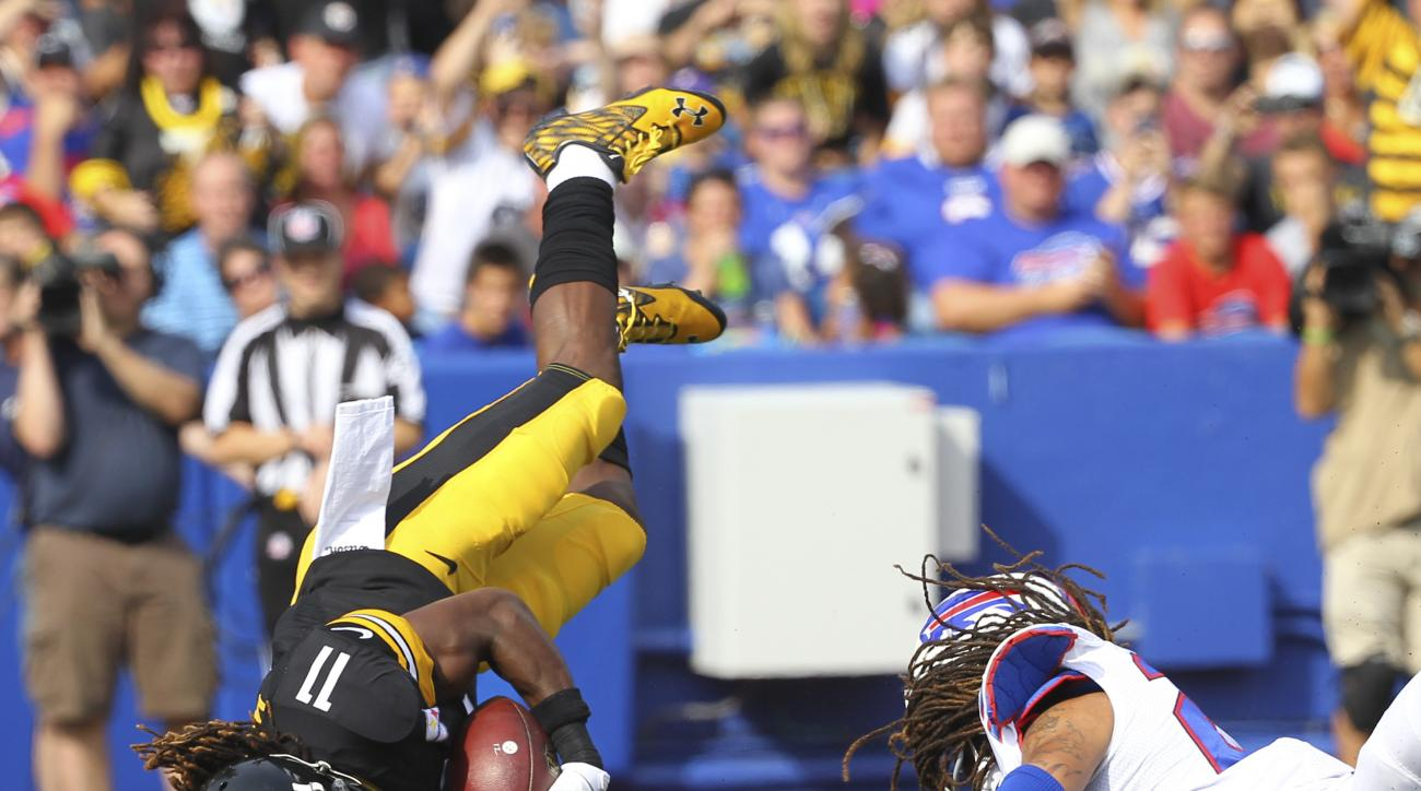 Pittsburgh Steelers wide receiver Markus Wheaton (11) is upended by Buffalo Bills cornerback Stephon Gilmore (24) during the first half of a preseason NFL football game on Saturday, Aug. 29, 2015, in Orchard Park, N.Y. (AP Photo/Bill Wippert)