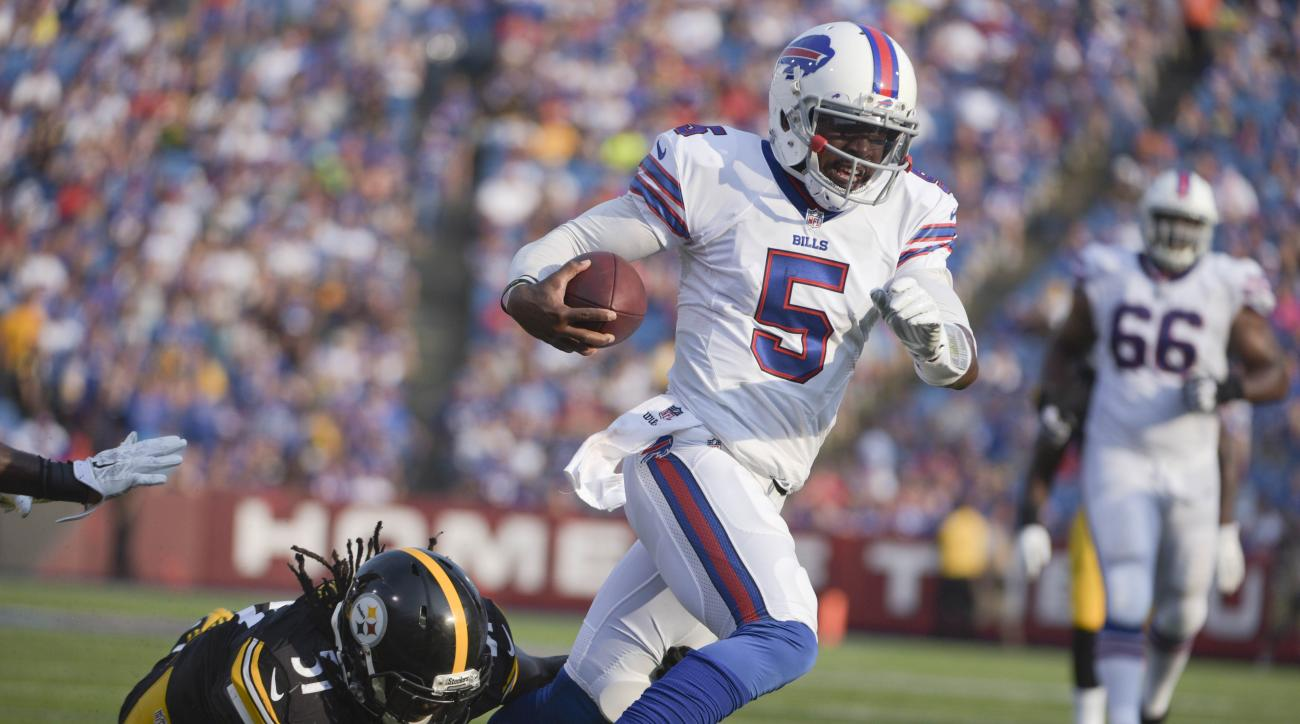 Buffalo Bills quarterback Tyrod Taylor (5) gets past Pittsburgh Steelers inside linebacker Sean Spence (51) on a touchdown run during the second half of a preseason NFL football game on Saturday, Aug. 29, 2015, in Orchard Park, N.Y. (AP Photo/Gary Wiepert