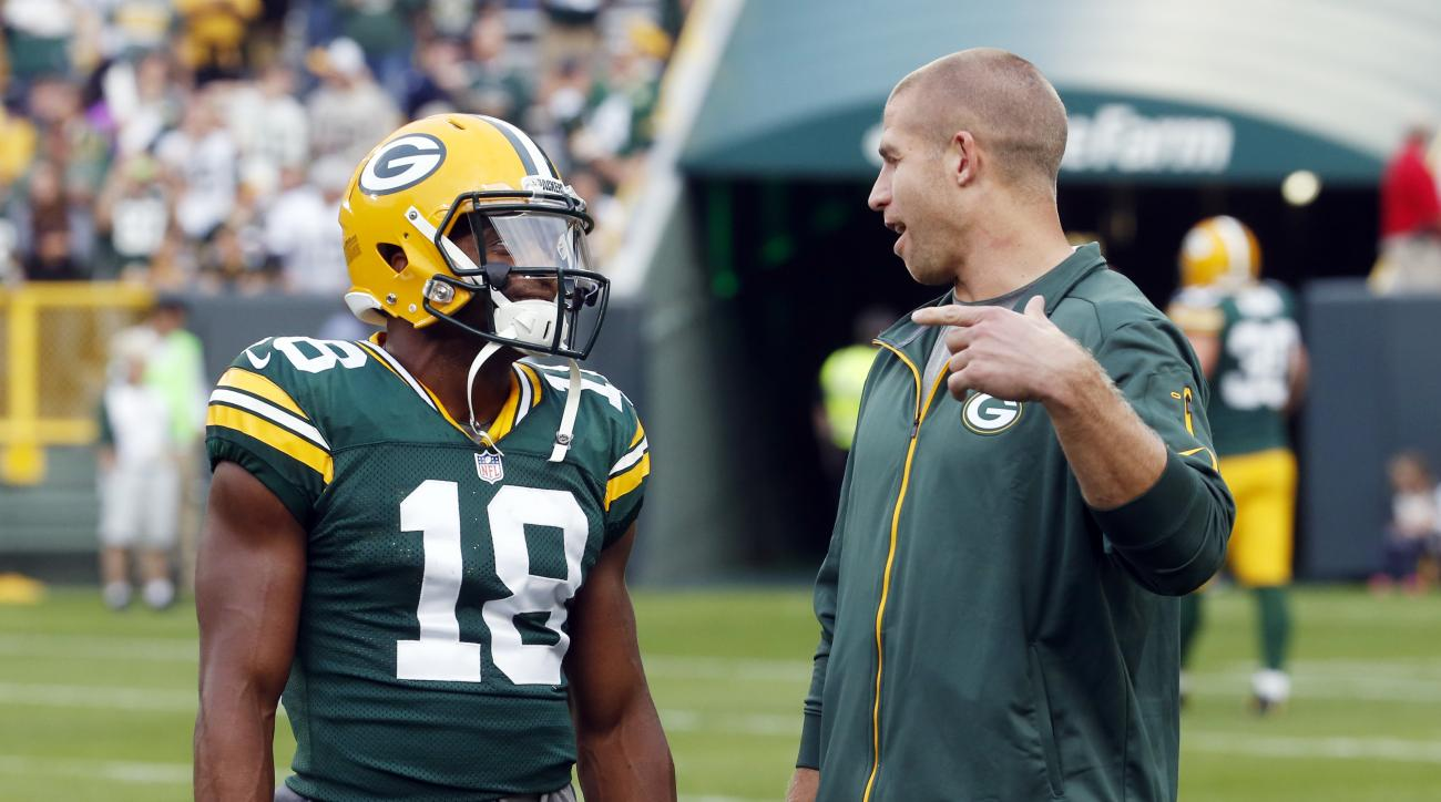 Green Bay Packers' Jordy Nelson talks to Randall Cobb (18) before a preseason NFL football game against the Philadelphia Eagles Saturday, Aug. 29, 2015, in Green Bay, Wis. (AP Photo/Mike Roemer)