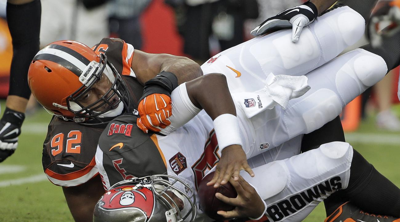Cleveland Browns defensive end Desmond Bryant (92) sacks Tampa Bay Buccaneers quarterback Jameis Winston (3) during the first quarter of an NFL preseason football game Saturday, Aug. 29, 2015, in Tampa, Fla. (AP Photo/Chris O'Meara)