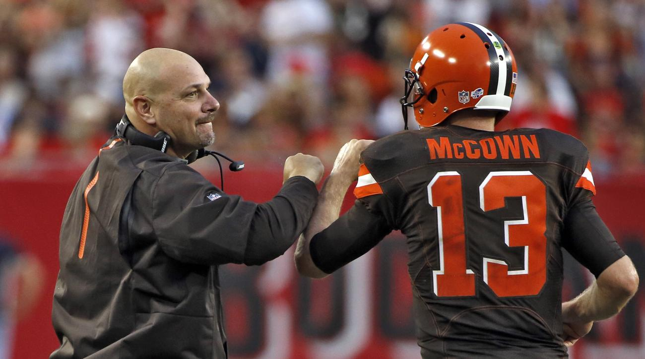 Cleveland Browns head coach Mike Pettine celebrates with quarterback Josh McCown (13) after McCown threw a touchdown pass against the Tampa Bay Buccaneers during the first quarter of an NFL preseason football game Saturday, Aug. 29, 2015, in Tampa, Fla. (