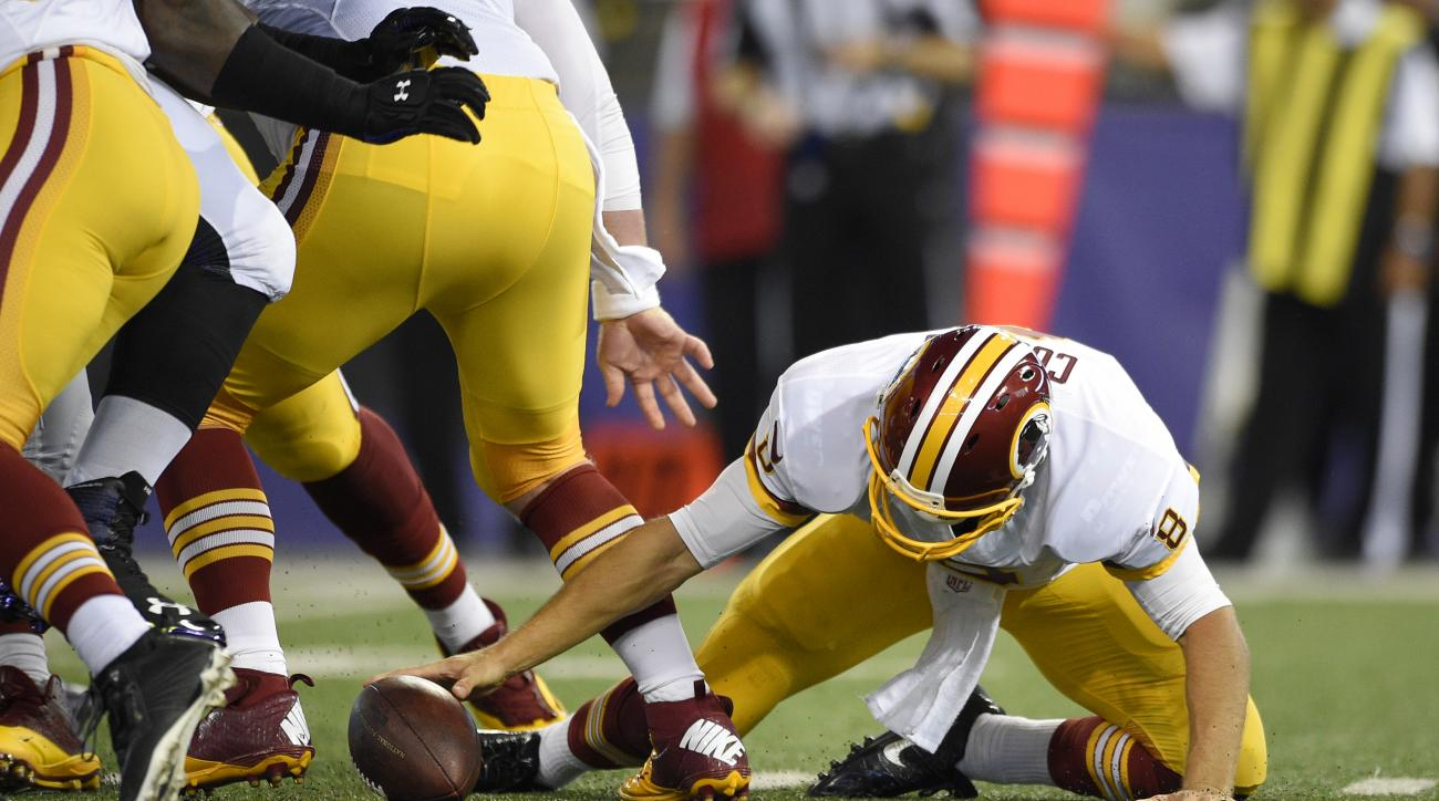 Washington Redskins quarterback Kirk Cousins chases after a fumble in the first half of a preseason NFL football gameagainst the Baltimore Ravens, Saturday, Aug. 29, 2015, in Baltimore. Cousins recovered the ball on the play. (AP Photo/Nick Wass)