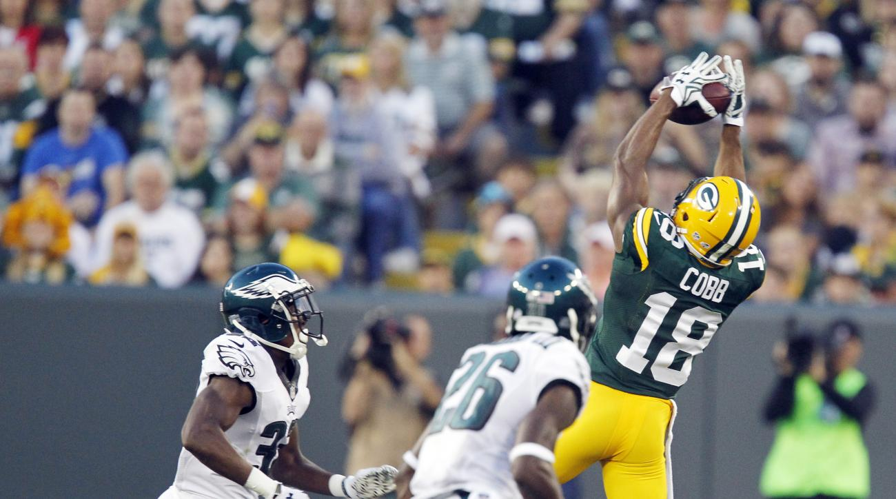 Green Bay Packers' Randall Cobb goes up for a pass during the first half of an NFL football game against the Philadelphia Eagles Saturday, Aug. 29, 2015, in Green Bay, Wis. Cobb left the field after the play. (AP Photo/Matt Ludtke)