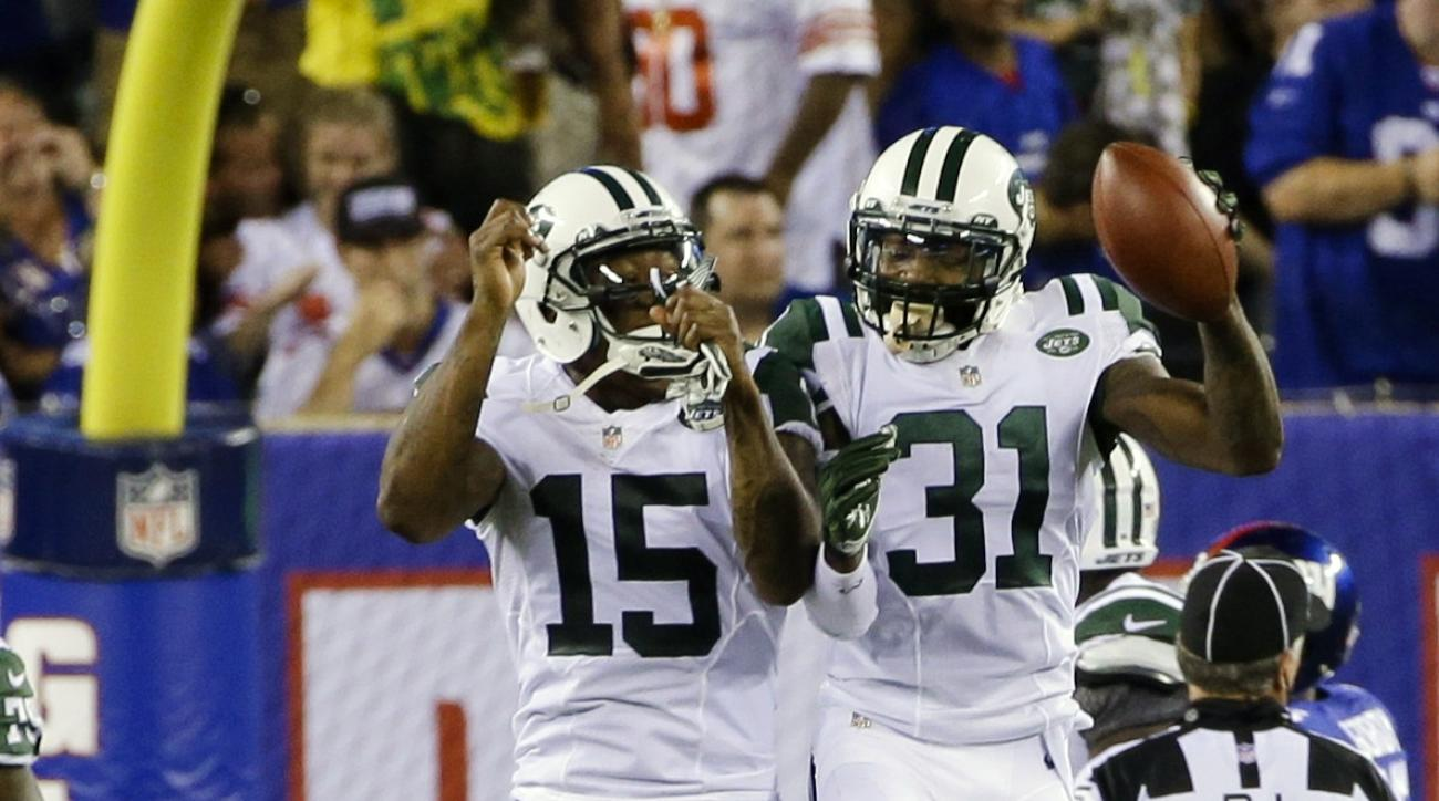 New York Jets defensive back Antonio Cromartie (31) and Brandon Marshall (15) celebrate after Cromartie scored a touchdown on an interception during the first half of a preseason NFL football game against the New York Giants, Saturday, Aug. 29, 2015, in E