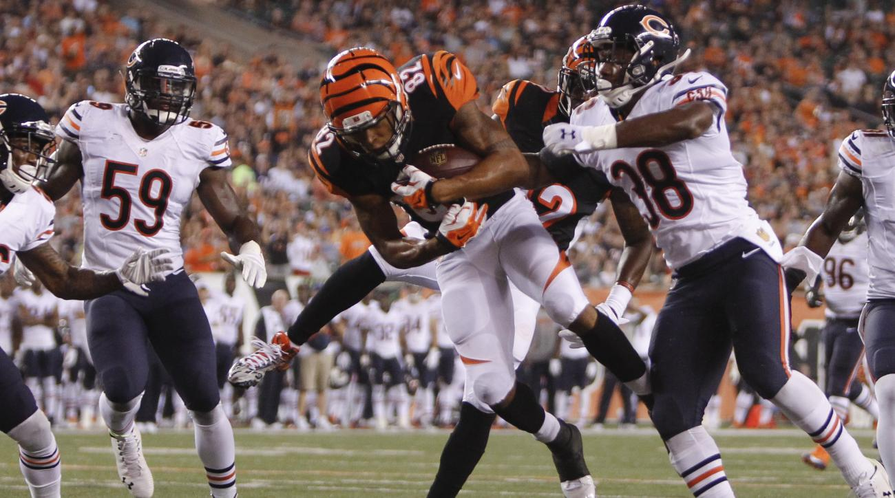 Cincinnati Bengals wider receiver Marvin Jones (82) goes up for a touchdown against Chicago Bears free safety Adrian Amos (38) during the first half of an NFL preseason football game, Saturday, Aug. 29, 2015, in Cincinnati. (AP Photo/Frank Victores)