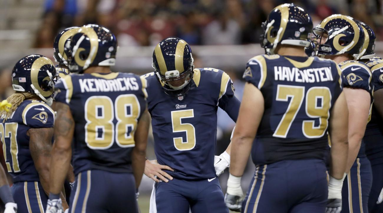 St. Louis Rams quarterback Nick Foles (5) looks down in the huddle during the first quarter of an NFL preseason football game against the Indianapolis Colts on Saturday, Aug. 29, 2015, in St. Louis. (AP Photo/Tom Gannam)