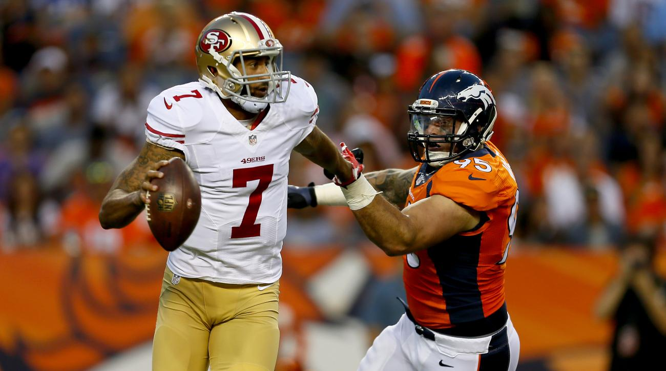San Francisco 49ers quarterback Colin Kaepernick (7) is pressured by Denver Broncos defensive end Derek Wolfe (95) during the first half of an NFL preseason football game, Saturday, Aug. 29, 2015, in Denver. (AP Photo/Joe Mahoney)