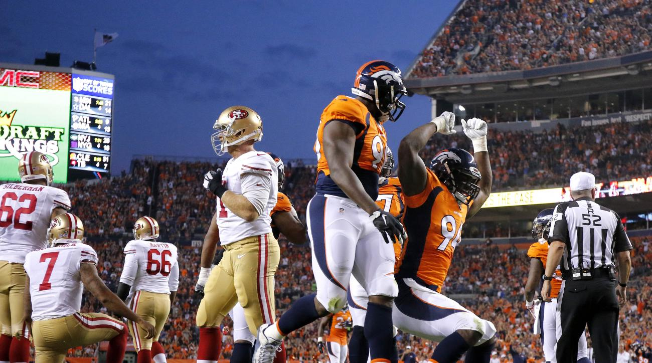 Denver Broncos defensive end DeMarcus Ware (94) celebrates his safety on San Francisco 49ers quarterback Colin Kaepernick (7) during the first half of an NFL preseason football game, Saturday, Aug. 29, 2015, in Denver. (AP Photo/Jack Dempsey)
