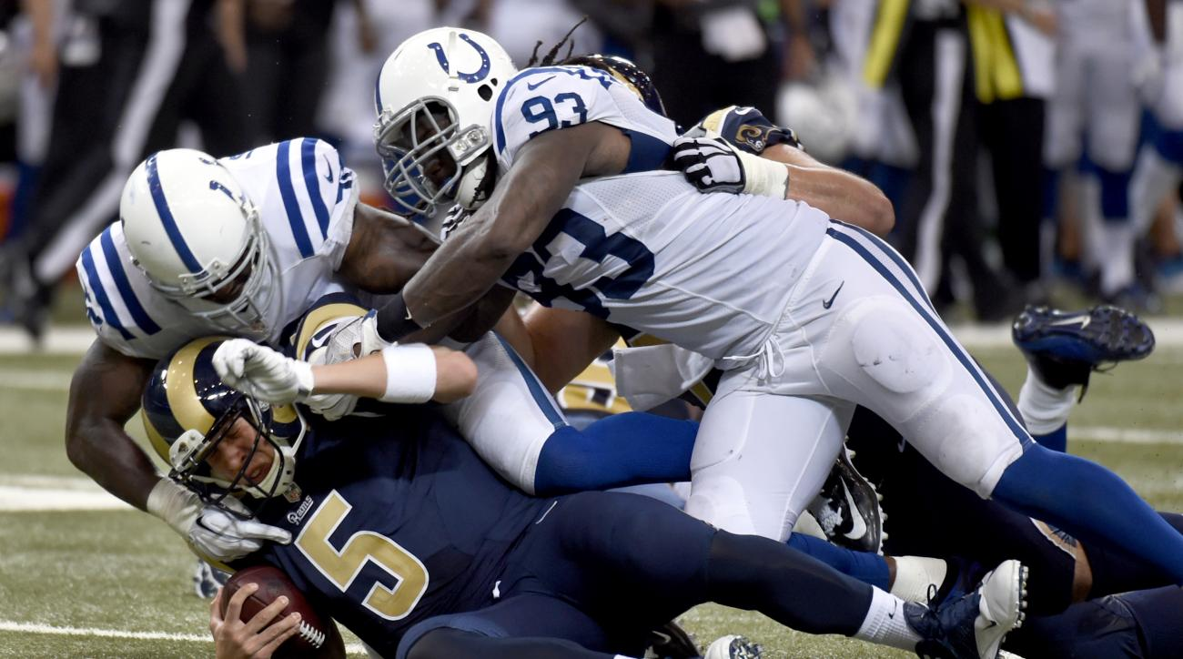St. Louis Rams quarterback Nick Foles (5) is sacked for a 10-yard loss by Indianapolis Colts' D'Qwell Jackson, top left, and Erik Walden during the second quarter of an NFL preseason football game Saturday, Aug. 29, 2015, in St. Louis. (AP Photo/L.G. Patt