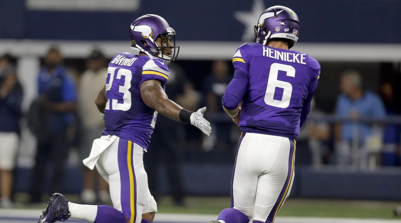 Minnesota Vikings running back Joe Banyard (23) and quarterback Taylor Heinicke (6) celebrate their touchdown against the Dallas Cowboys during the second half of a preseason NFL football game Saturday, Aug. 29, 2015, in Arlington, Texas. (AP Photo/Brando