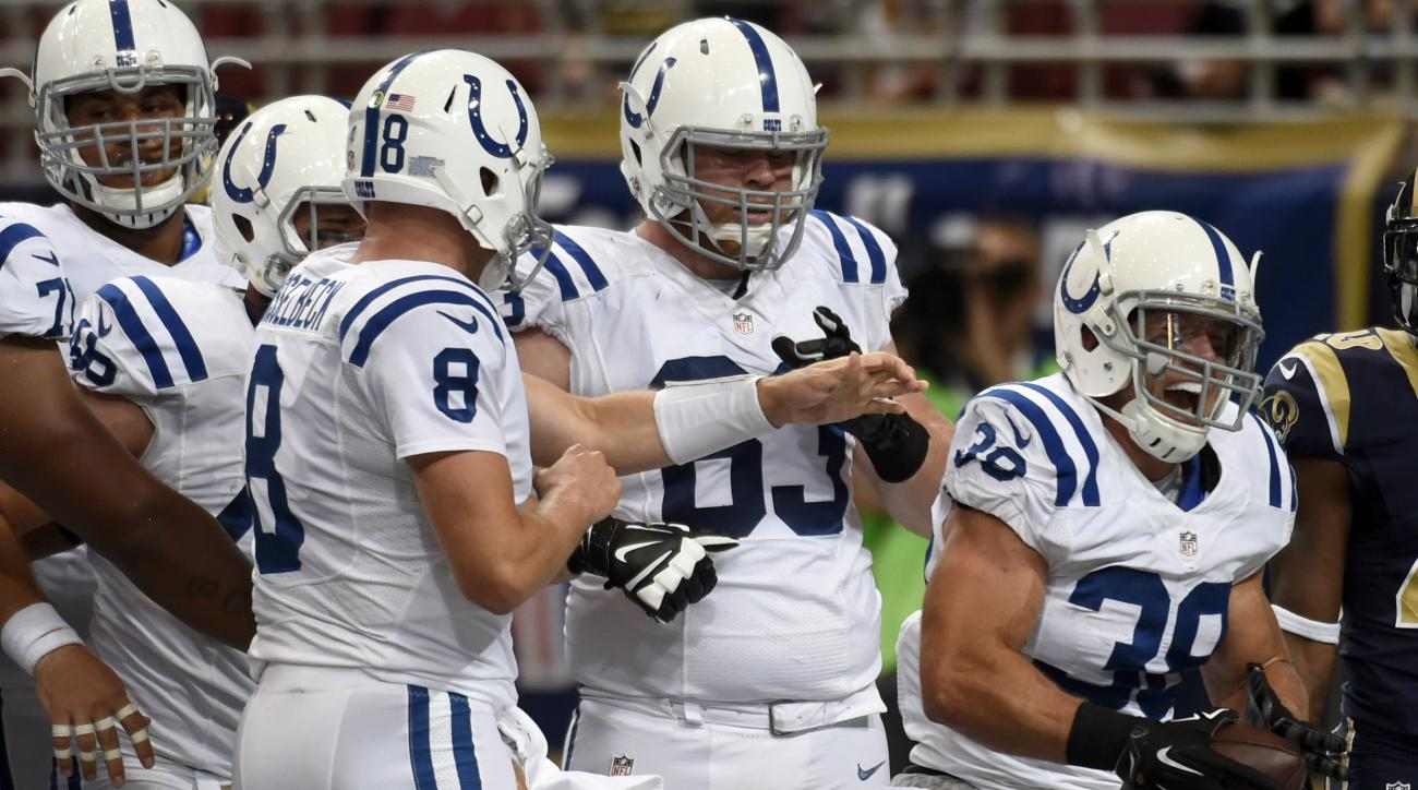 Indianapolis Colts fullback Tyler Varga, right, celebrates after scoring on a 1-yard run during the fourth quarter of an NFL preseason football game against the St. Louis Rams on Saturday, Aug. 29, 2015, in St. Louis. (AP Photo/L.G. Patterson)