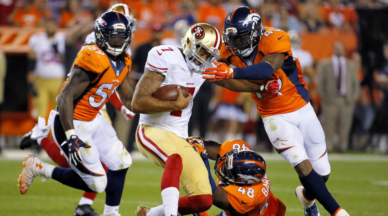 San Francisco 49ers quarterback Colin Kaepernick (7) is tackled by Denver Broncos' Shaquil Barrett (48), T.J. Ward (43) and Danny Trevathan (59) during the first half of an NFL preseason football game, Saturday, Aug. 29, 2015, in Denver. (AP Photo/Jack De